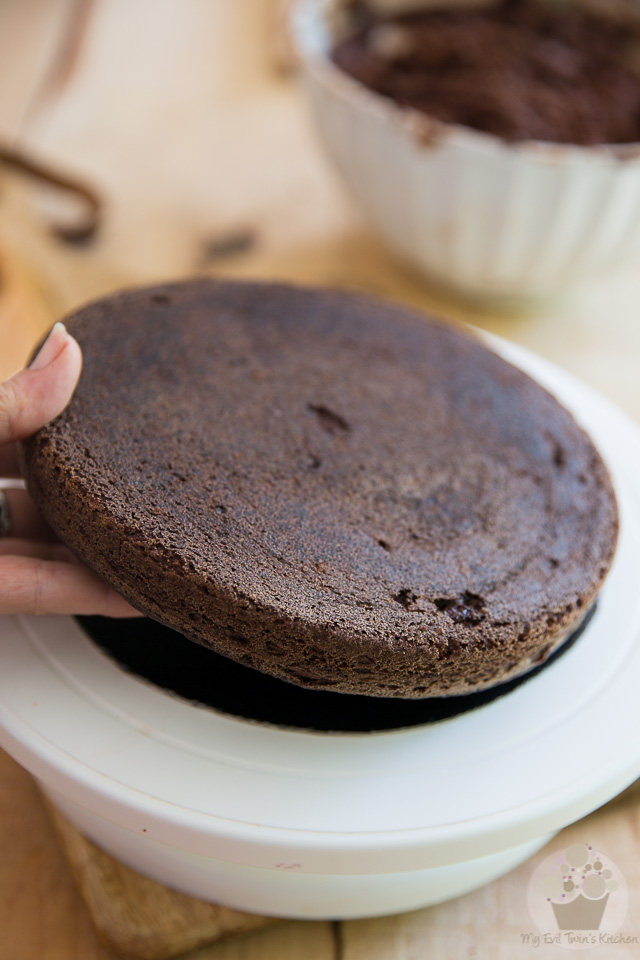 Place the cake on a round cardboard - part of My Evil Twin's Kitchen's Wicked Windmill Chocolate Cake step-by-step instructions