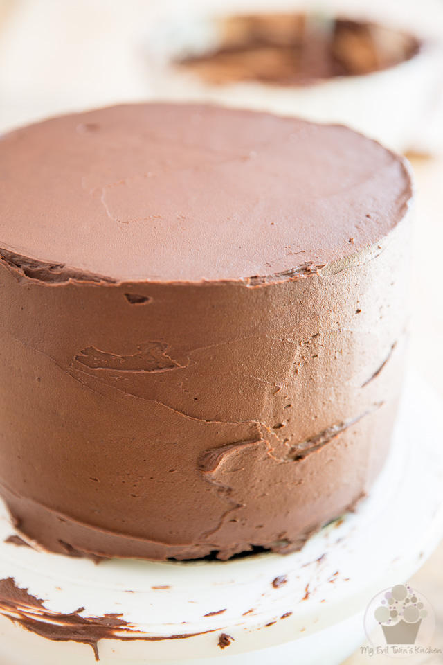 Cover the entire cake in frosting - part of My Evil Twin's Kitchen's Wicked Windmill Chocolate Cake step-by-step instructions