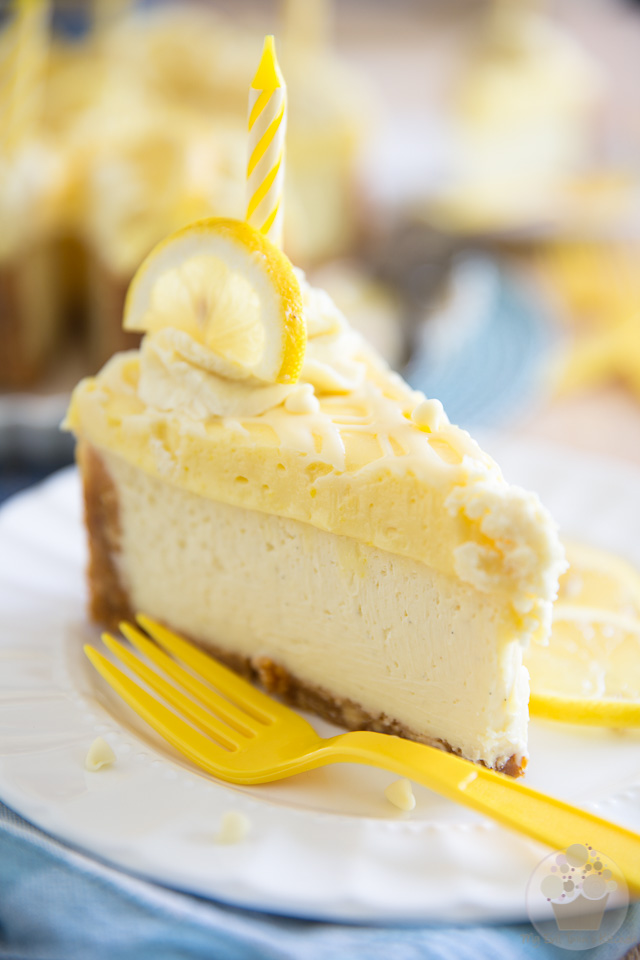 This White Chocolate Lemon Curd Cheesecake is so creamy and dreamy, your taste buds will think they have died and gone to heaven. It feels like you're eating a refreshing, lemony slice of the most unctuous cheesecake, topped with the most insanely delicious lemon pie. Click for the recipe; you know you want it!